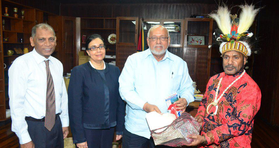 Benny (far right) pictured presenting the President of Guyana (second right) with a West Papua flag and documentation about the ongoing struggle for freedom in West Papua. Also pictured is Melinda Janki (co-founder of International Lawyers for West Papua), and the Deputy Foreign Minister of Guyana (left)